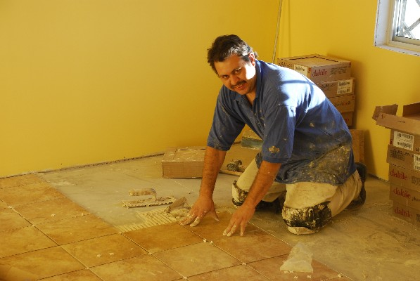 Luis Carlos laying tile!
